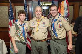 ScoutLeader-2-scouts_AmFlags-on-stands_2018